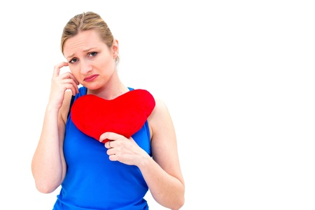 lonely heart: young lonely sad woman holding red valentine heart Stock Photo