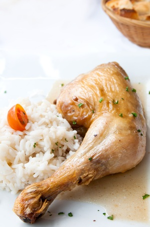 Rice and chicken on white plate