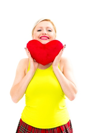 beautiful young woman holding a red heart photo