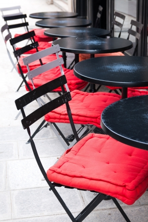 Street view of a coffee terrace with tables and chairs,paris France Stock Photo - 17315781