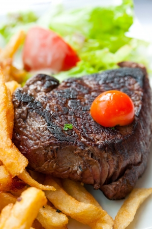 juicy steak beef meat with tomato and french fries  photo