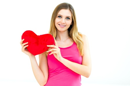 beautiful young woman holding a red heart Stock Photo - 17406051