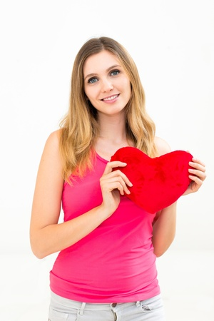 beautiful young woman holding a red heart Stock Photo - 17406053