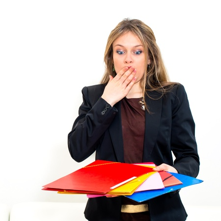 unhappy woman with folders on white background photo