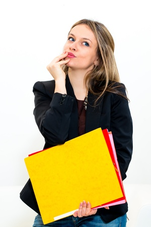 Thinking expression woman in office photo