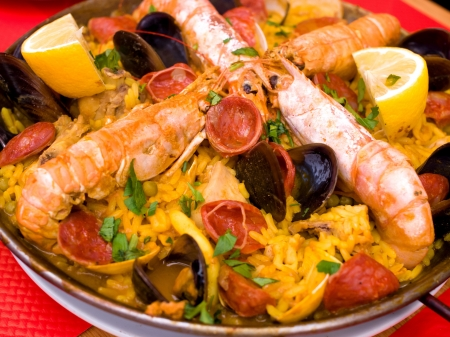 Prawn with rice - closeup of prawn with rice - traditionnal spanish food paella photo