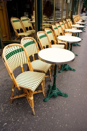 Street view of a coffee terrace with tables and chairs,paris France photo