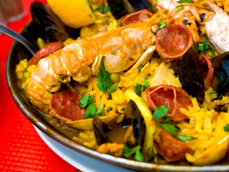 Prawn with rice - closeup of prawn with rice - traditional spanish food paella  photo