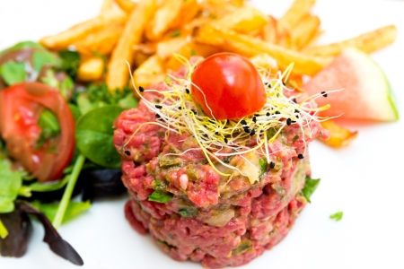 tasty tartare Raw beef  - classic steak tartare on white plate photo