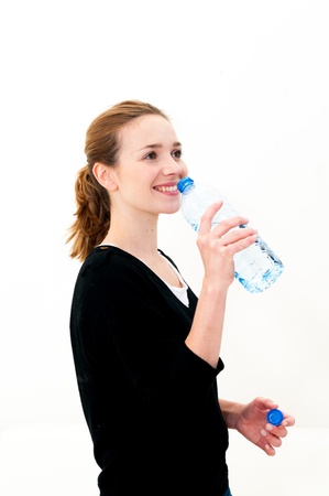 Young woman drinking water against white background Stock Photo - 18098627
