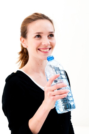 Young woman drinking water against white background Stock Photo - 18098644