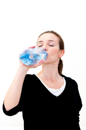 Young woman drinking water against white background Stock Photo - 18098620