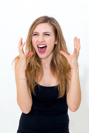 nervousness: young expressive irritated woman making a face on white background