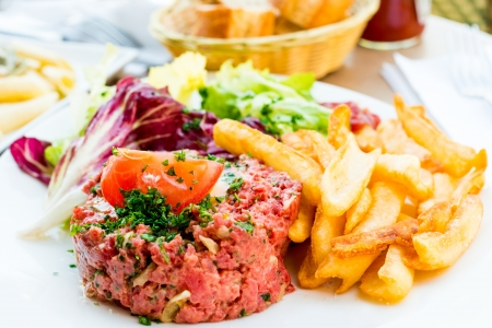 tasty tartare(Raw beef) - classic steak tartare on white plate photo