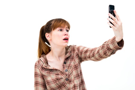 Frustrated Woman on Phone on white background  photo