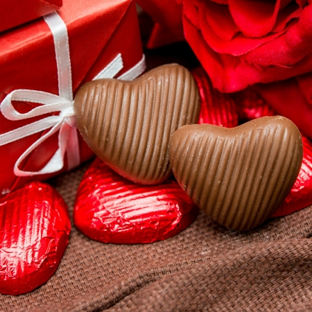 chocolate, gift box and flowers for Valentines day photo