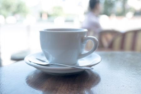 cup of hot coffee on table photo