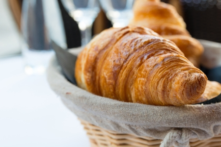 traditionally french: fresh croissant on table ,Delicious!