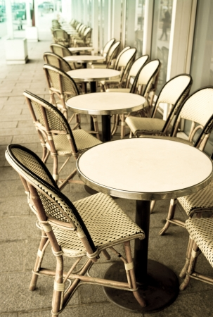 Street view of a coffee terrace with tables and chairs,paris France