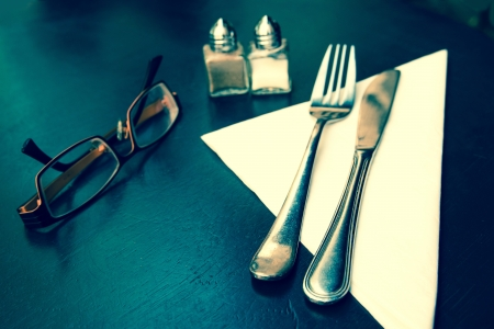 table setting - plate, knife and fork on table Stock Photo - 18940449