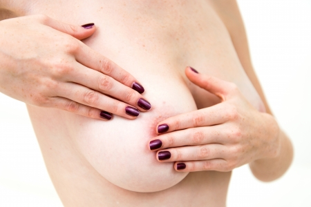 breast control - Woman holding her breast photo