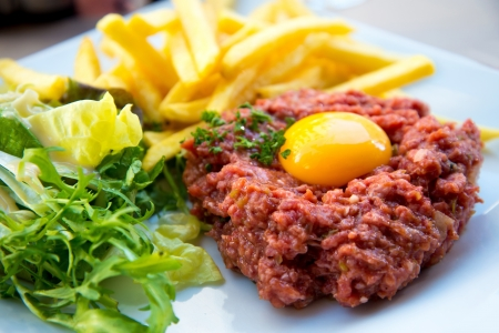 tasty Steak tartare (Raw beef) - classic steak tartare on white plate photo