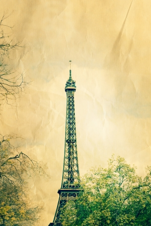 retro style Eiffel Tower (nickname La dame de fer, the iron lady),The tower has become the most prominent symbol of both Paris and France Stock Photo - 19916935