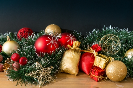 Christmas decoration and gift boxes over dark background photo