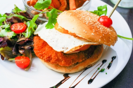 American cheese chicken burger with fresh salad photo