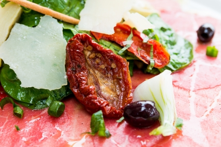 laureate: Fresh Sliced raw beef meat with leaf lettuce on the table  Stock Photo