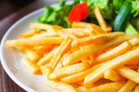 Golden French fries potatoes ready to be eaten photo