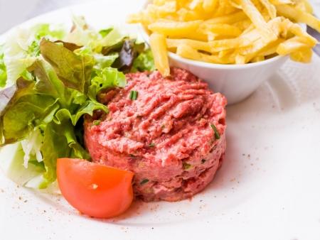 steak tartare: tasty Steak tartare (Raw beef) - classic steak tartare on white plate