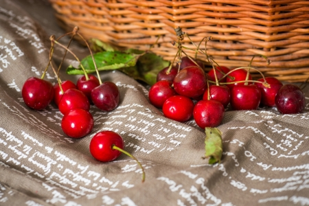 fresh cherries on brown napkin photo