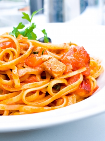 Spaghetti with aubergine and tomato on a the table photo