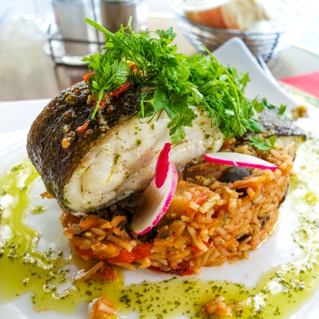 grilled salmon and rice- french dish on the table  photo