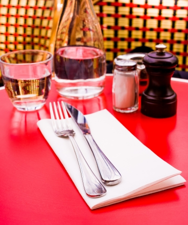 table setting - plate, knife and fork on table photo