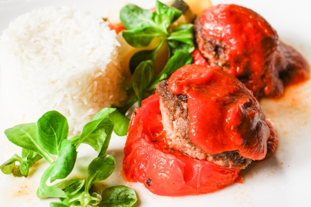 stuffed tomatoes with meat on a white plate  photo