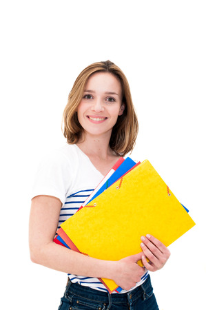 Young smiling woman with Folders. Isolated on white background photo