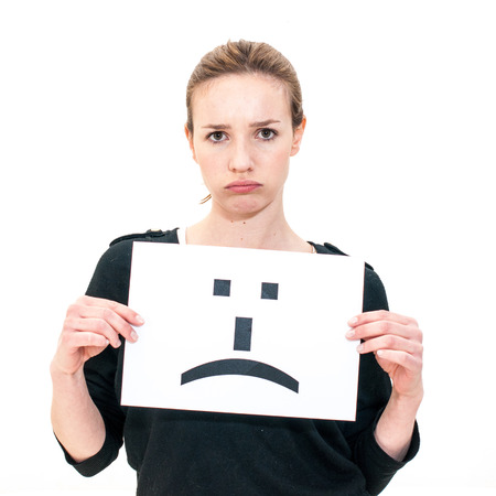 expressive face: portrait young woman with board sad emoticon face sign  Stock Photo