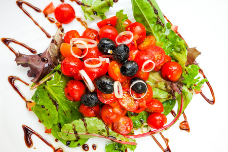 Fresh salad with tomatoes and olive oil photo