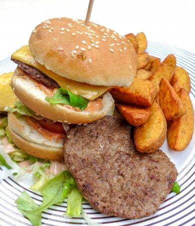 Cheese burger - American cheese burger with fresh salad   photo