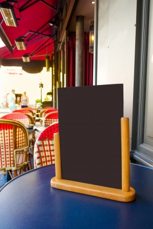 Paris street view of a Restaurants terrace with blackboard