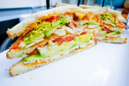 cuisine entertainment: Sandwich with chicken, cheese  on table