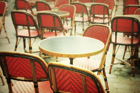 ambiance: old-fashioned coffee terrace with tables and chairs,paris France