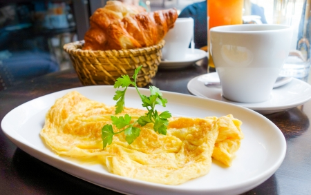 omelet with ham and croissants photo