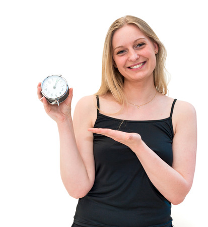 beautiful young woman holding alarm clock  photo