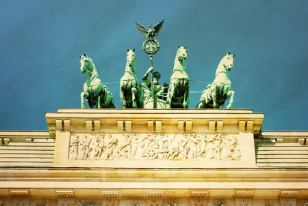 retro style Brandenburg Gate (Brandenburger Tor), famous landmark in Berlin, Germany,rebuilt in the late 18th century as a neoclassical triumphal arch photo