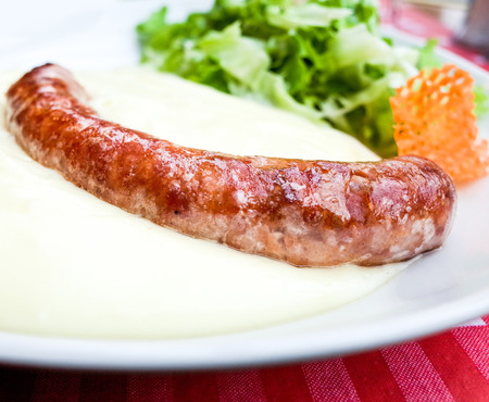 Grilled sausage served with  mash potatoes photo
