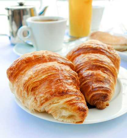 traditionally french: Breakfast with coffee and croissants on table Stock Photo
