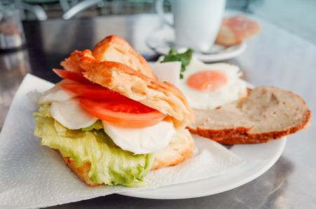 cuisine entertainment: Sandwich with bacon, tomato- chicken, cheese and lettuce